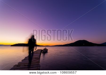 Man ghosty silhouette walking on The pier and beautiful sky