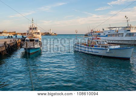 Pleasure and fishing boats are waiting for the tourists