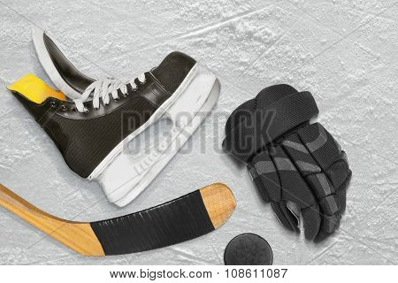 Hockey Skates, Stick, Gloves And Puck