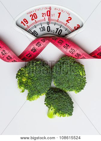Broccoli With Measuring Tape On Weight Scale. Dieting