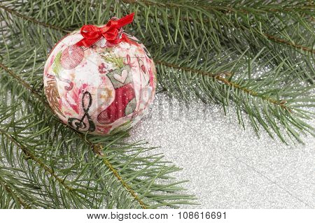 Decoupage Christmas Ornament And Fir Tree On Shiny Background