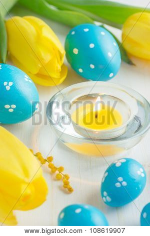 Easter Eggs And Tulips On White Background, Selective Focus