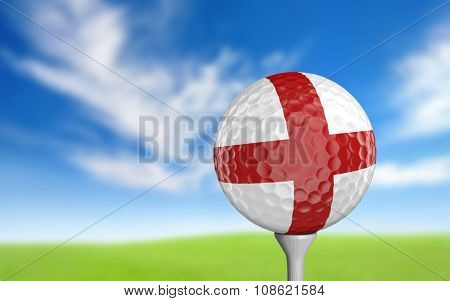 Golf ball with England flag colors sitting on a tee
