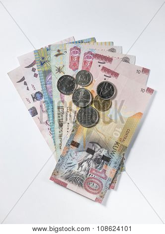 Assorted currency notes and coins from Gulf countries. Stock image.