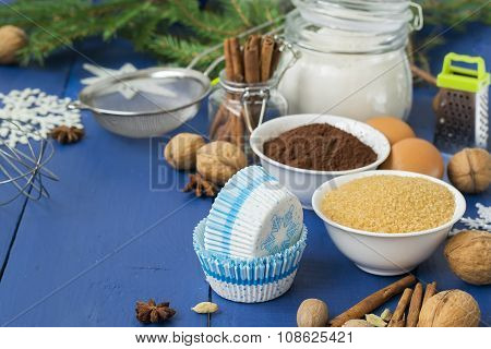 Ingredients For Baking Christmas Muffins On Wooden Background. Selective Focus