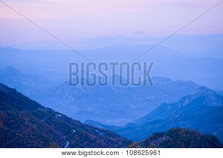 Landscape with the image of mountain sunset