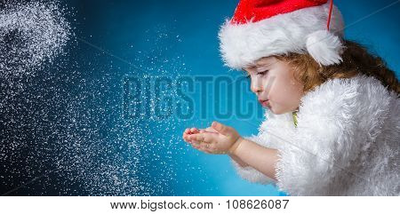 Holidays, Presents, Christmas, Childhood Concept - Happy Little Girl Over Blue Background.