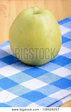 Fresh Green Apple On Blue Material Backgound