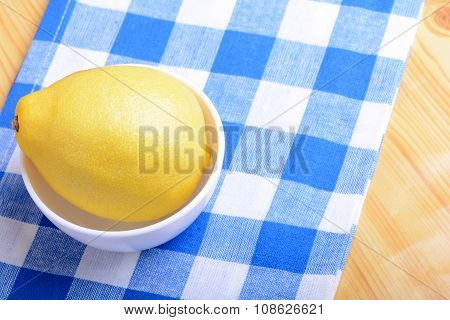 Ripe Lemons On A White Plate