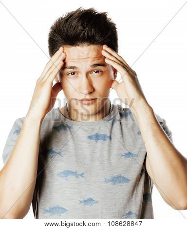 young pretty man with head ache holding hands isolated close up