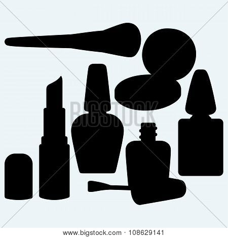 Make-up brushes in holder and cosmetics