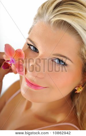 Beautiful Young Fresh Female Face With Healthy Skin And Natural Make-up And Flower. Isolated On Whit