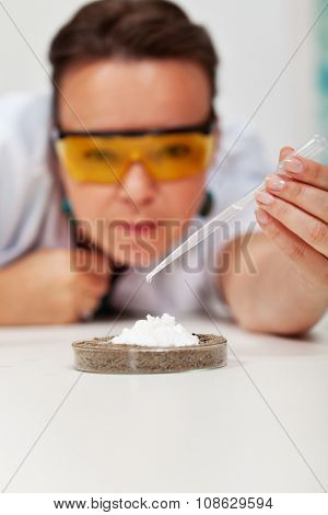 Teacher demonstrating simple chemical experiment in elementary science class - closeup