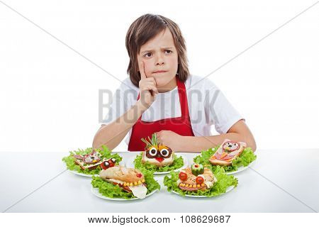 Young chef thinking about the next creative sandwich idea to make - isolated