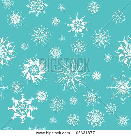 Elegant white snowflakes of various styles isolated on blue background.