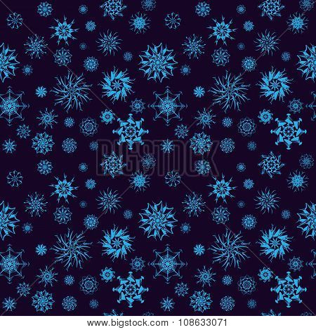 Elegant neon blue snowflakes of various styles isolated on dark blue background
