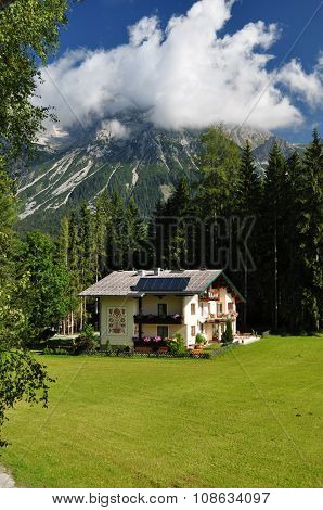 House In Front Of Dachstein Mountain, Styria, Austria