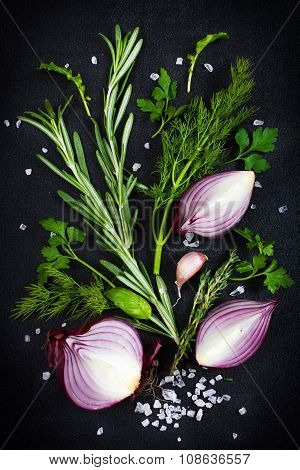 Fresh Aromatic Herbs With Red Onion, Garlic And Sea Salt On A Black Background , Top View
