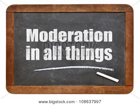 Moderation in all things reminder or warning - white chalk text on a vintage slate blackboard