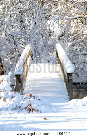 Head On View Of A Bridge Over A Stream Following A Heavy Snow In
