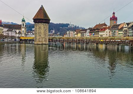 Kapellbr?cke or Chapel Bridge in Lucerne with its water tower seen in the middle. It serves as the citys symbol and as one of Switzerlands main tourist attractions