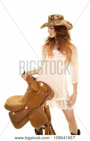 Red Head Cowgirl Hold Saddle Look To Side