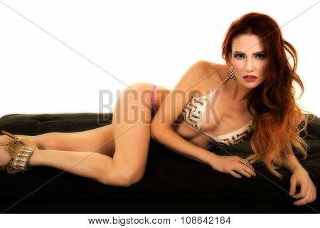 Red Headed Woman In Bikini Lay On Side Look
