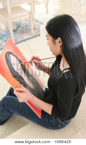 Woman Painting Portrait (Focus On Painter)