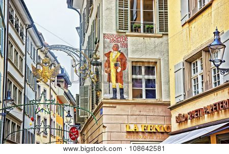 LUCERNE SWITZERLAND - JANUARY 04 2015: Old medieval house where Wolfgang von Goethe stayed during his visit to Lucerne and a bronze lantern in the form of double-headed eagle in the imperial crown