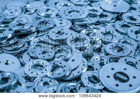 Pile of blue aluminum spacers