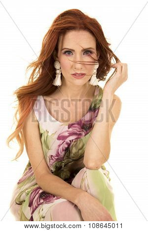Woman Sit In Flower Dress Red Hair Look Serious