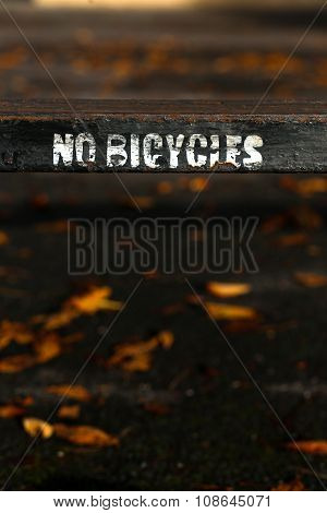 No Bicycles Painted Sign On Old Rusty Metal Fence In Oxford, Uk.