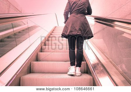 Young Girl Standing On Escalators Stairway With Back Light Contrast  - Modern  Concept - Vintage Fil