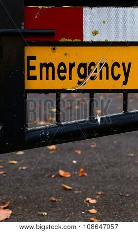 Emergency Sign Gated Street Close Up