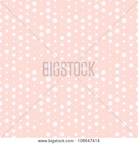 Cute pink and white dotted seamless pattern.