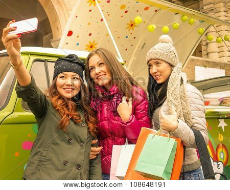 Three Girls Taking Selfie In The City After Shopping - Soft Focus - Fashion Concept -