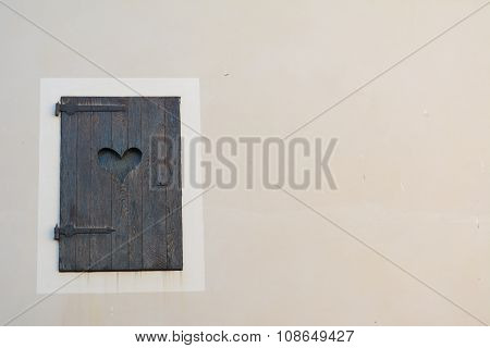 Old wooden shutter with cut out love heart