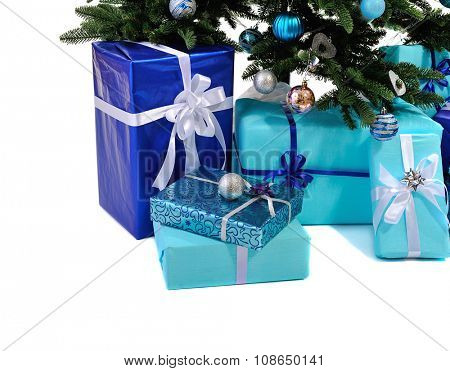 blue Christmas gifts under tree isolated on white background