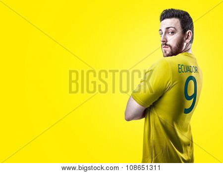 Ecuadorian soccer player player on yellow background