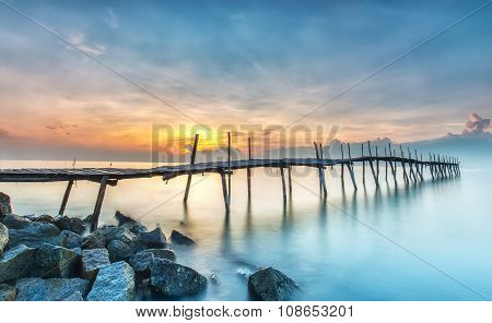 Sunrise on a wooden bridge