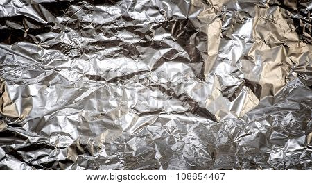 Crumpled Aluminum Foil Texture Background High Contrasted With Vignetting Effect