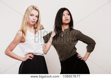 Two Fashion Women Caucasian And African
