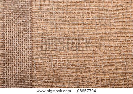 Jute Ribbon On Burlap Cloth Background