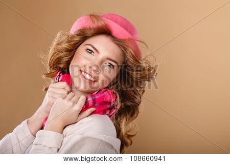 Girl With Curly Hair In Pink Hat And Scarf.