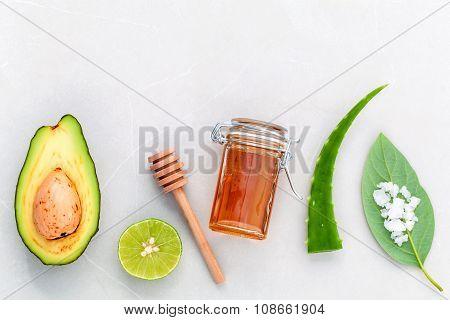 Alternative Skin Care  And Scrub Fresh  Avocado , Leaves ,sea Salt , Oils, Lime And Honey On Marble