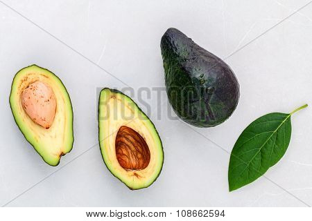 Alternative Health Care Fresh  Avocado And Leaves On Marble Background.