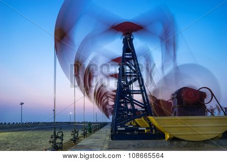 working oil-rigs on oilfield day and night