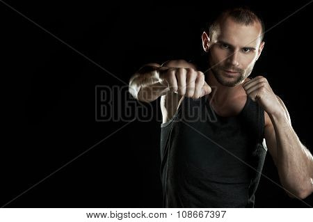 muscular man, hour boxer, black background, horizontally