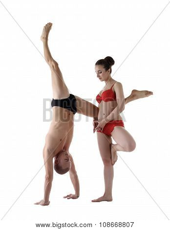Paired yoga. Man and woman performing asanas