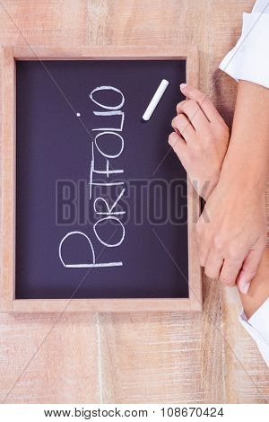 Chalkboard with portfolio text on wood desk